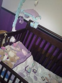 baby's brown wooden crib 3 in 1 with matress