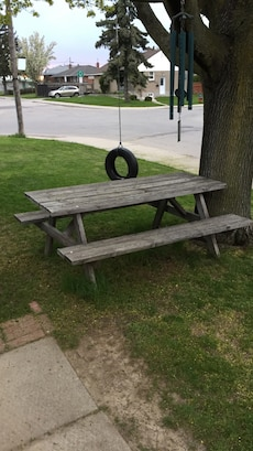 Brown wooden picnic table