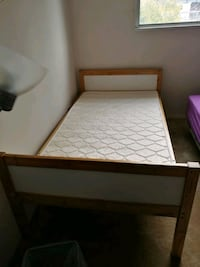Ikea wooden bed with thin mattress Burnaby, V5H 1C8