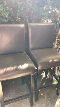 black leather padded armless chair