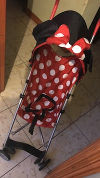 baby's red and white Minnie Mouse polka dot simple stroller