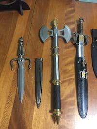 gray short sword with sheath and battle axe