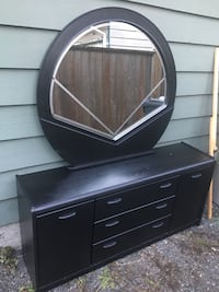 Black dresser 61inches long 29inches tall18inches thick. 3716 km