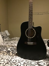 Black and brown acoustic guitar Simon and Patrick//built in tuner//great condition  Winnipeg, R2X 1N3