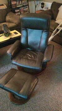 brown leather padded reclining armchair