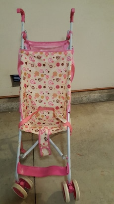 baby's white-and-pink floral stroller