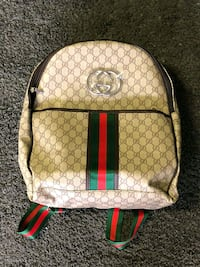 brown and red Gucci backpack