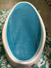 White and blue plastic bather