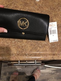 Michael Kors carry all womans  leather wallet Smithtown, 11787