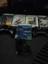 Xbox 360 console with controller and game cases Surrey, V3V 6C4