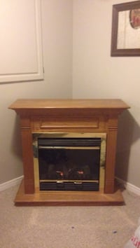 brown wooden framed electric fireplace Kingston