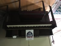 Used upright piano North Potomac