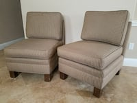 2 brown armless accent chairs