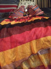 red, yellow, black, and brown striped textile