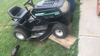 black and green Craftsman ride on mower 67 km