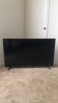 black flat screen TV with remote Los Angeles, 90034