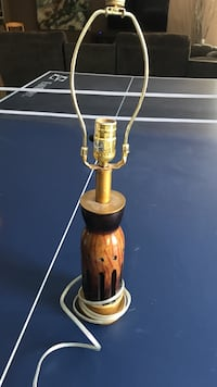 brown and gold-colored table lamp base 1281 km