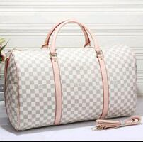Louis vuitton women leather luggage travel bag **READ BELOW **