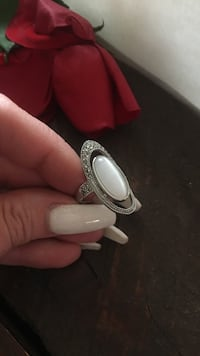 silver-colored ring with white gemstone