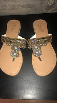 pair of brown leather thong sandals Toronto, M5V 2B5