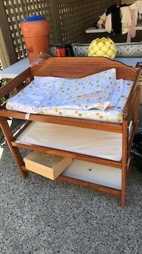 brown wooden crib with mattress Burnaby, V5A