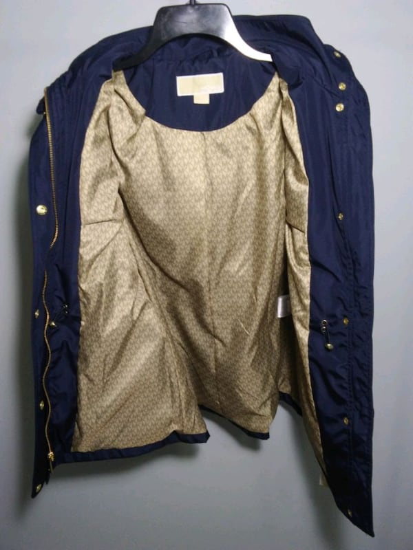 Michael Kors rain coat. Size S. Navy blue. New with tags. Retail $220. fae82551-058e-4a03-bc42-acfa4aae678e