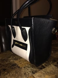 White and black leather bag