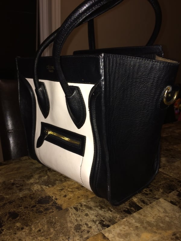 White and black leather bag 809e81b1-0bbc-4f07-a417-61b06643bbe5
