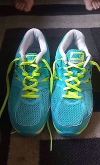 pair of blue-and-green Nike running shoes Moncton, E1C 6N5