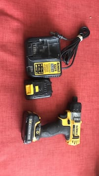 black and yellow DeWalt cordless impact driver with charger