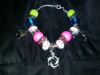 beaded pink, green, and white silver-colored dolphin bracelet