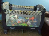 baby's white green and black Graco pack and play crib Reston, 20190