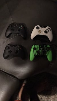 two Xbox One game controllers 2253 mi