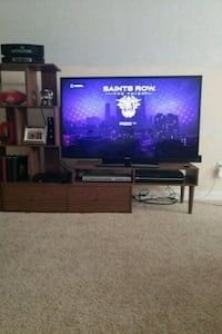black flat screen TV with brown wooden TV stand Grove City, 43123