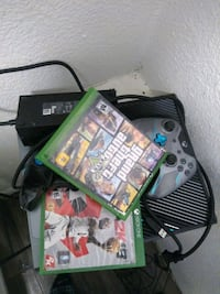 black Xbox One console with controller and game cases Stockton, 95202