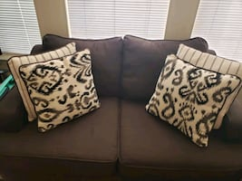 Brown couches with cushions