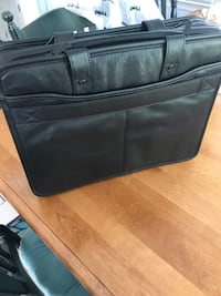 Genuine leather dell computer briefcase. Brand new never used multiple compartments and long strap included Miller Place, 11764