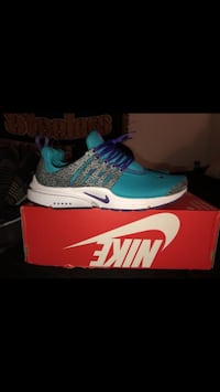 teal-and-white Nike running shoes with box Houston