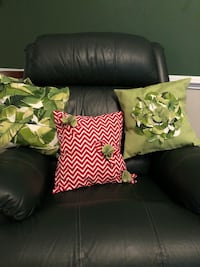 three assorted colored throw pillows