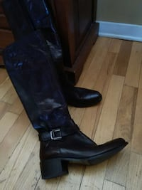 pair of black leather knee-high boots Gatineau, J8T 5N7