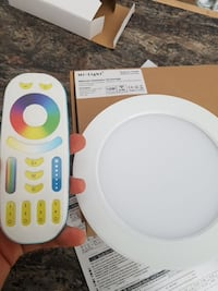 white round device with remote