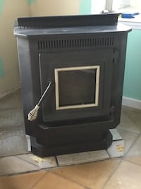 New England Pellet stove with pipes works great. Also have a bag of pellets to go with it.