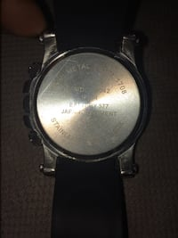 Round silver chronograph watch with black leather strap 55 km