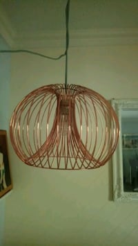 Copper wire hanging light.