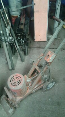 rusty red and gray metal power tool