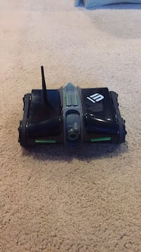 Black and green plastic toy car