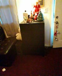 brown wooden tallboy dresser