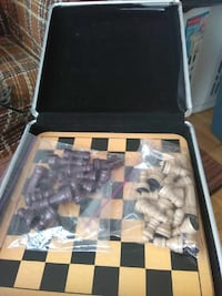 brown and black chess board set with case Alexandria, 22304