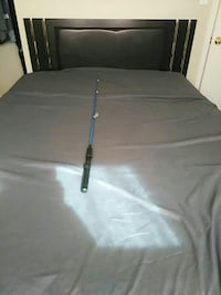 blue and black fishing rod