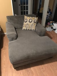 gray fabric sofa chair with throw pillow 233 mi